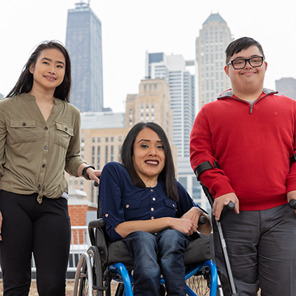 Group shot of young adults with disabilities in front of Chicago skyline