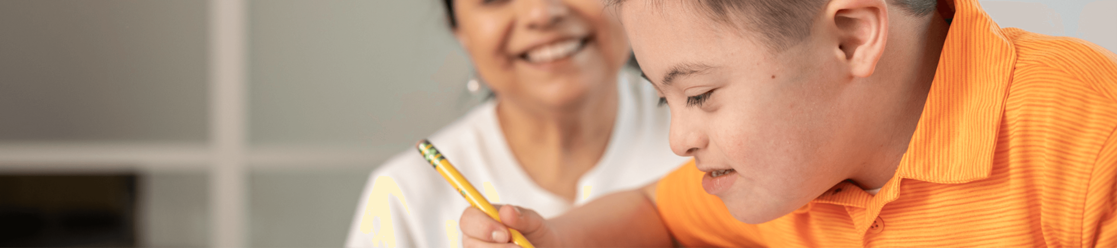 Grade schooler with Down syndrome does homework with mom